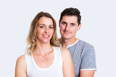 Young couple in an embrace. In front of white background Royalty Free Stock Photos