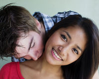 Young couple embrace and kiss. In candid happy cute romantic natural moment Royalty Free Stock Images