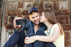 Young couple in embrace takes selfie. Couple in embrace takes selfie Royalty Free Stock Photography