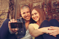 Young couple in embrace takes selfie. Happy couple in embrace takes selfie Stock Photos
