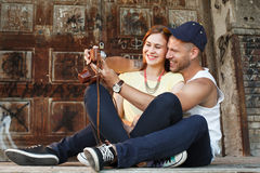 Young couple in embrace takes selfie with an old camera. Happy couple in embrace takes selfie with an old camera Stock Photos
