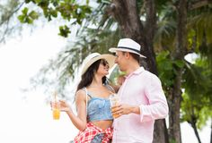 Young Couple Embrace While Walking In Park On Seaside Happy Man And Woman Tourists In Love On Vacation. Holiday And Relationship Concept Royalty Free Stock Photography