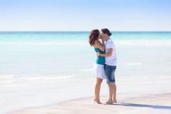 Young Couple Embraced in a Caribbean Beach Stock Image