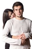 Young couple embracing. Looking at camera Stock Image