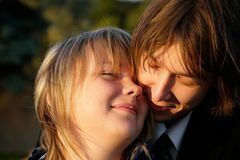 Young couple embracing. Close-up portrait Stock Image