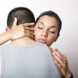 Young couple embracing. Only female face is visible Stock Images