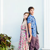 Young couple embracing back to back Royalty Free Stock Photo