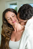 Young couple embracing in bathroom Stock Photos