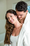 Young couple embracing in bathroom Royalty Free Stock Image