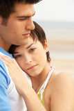 Young Couple Embracing On Beach Stock Image