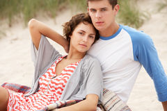 Young Couple Embracing On Beach stock photo