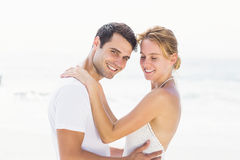 Young couple embracing on the beach Royalty Free Stock Photography