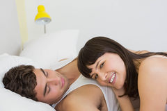 Young couple embracing on bed Royalty Free Stock Image