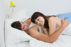 Young couple embracing on bed Royalty Free Stock Photo