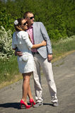 Young couple embracing on country road stock photography