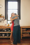 Young couple embracing each other in kitchen Royalty Free Stock Image