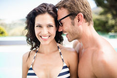 Young couple embracing each other near pool Stock Photography