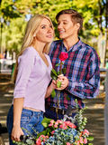 Young couple embracing and flirting in  park. Royalty Free Stock Images