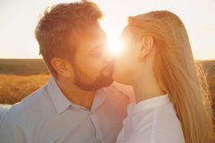 Young couple embracing and kissing outdoor. At sunset Stock Photography
