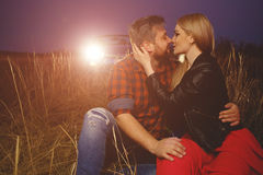 Young couple embracing and kissing outdoor. At sunset Royalty Free Stock Images