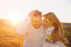 Young couple embracing and kissing outdoor. At sunset Stock Photo