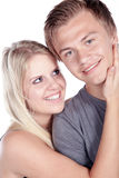 Young couple embracing and laughing Royalty Free Stock Image