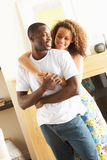 Young Couple Embracing In Living Room Royalty Free Stock Image