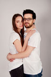 Young couple embracing and looking at the camera Stock Photography