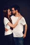 Young couple embracing and looking at each other Stock Photo