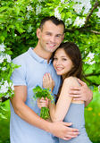 Young couple embracing near blossomed tree Royalty Free Stock Images