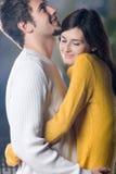 Young couple embracing, outdoors Stock Photos