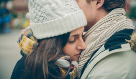 Young couple embracing outdoors in a cold autumn Royalty Free Stock Image