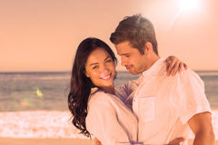 Young couple embracing and posing on the beach Stock Images