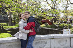 Young couple embracing in the Sensoji shrine garden Royalty Free Stock Image