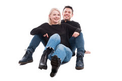 Young couple embracing and sitting on the floor royalty free stock image