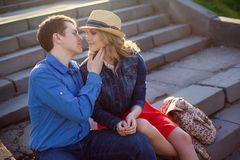 Young couple embracing on steps. Royalty Free Stock Image