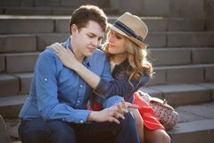 Young couple embracing on steps. Stock Image