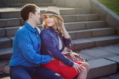 Young couple embracing on steps. Stock Photo