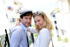Young couple embracing in the street Stock Image