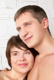 Young couple with emotions of hope near the white wall Royalty Free Stock Image
