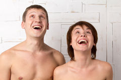 Young couple with emotions of joy near the white wall Stock Photography