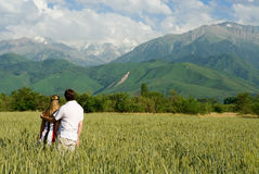 Young couple enjoing beauty of nature Royalty Free Stock Photography