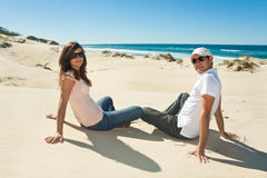 Young couple enjoy beautiful day on the beach Royalty Free Stock Photography