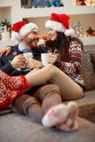 Young couple enjoy at home for Christmas Royalty Free Stock Images