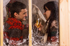 Young couple enjoy a romantic glass of champagne Stock Photography