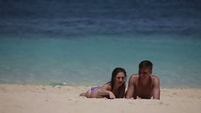 Young couple enjoy a summer beach vacation stock video