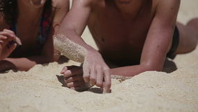 Young couple enjoy a summer beach vacation. stock footage