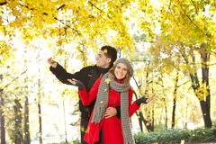 Young couple enjoying in autumn Stock Photography