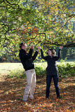 Young couple enjoying the autumn forest Royalty Free Stock Photos