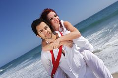 Young couple enjoying on the beach Royalty Free Stock Image